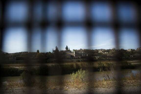 View of Juarez, Mexico through the border fence from El Paso, Texas.