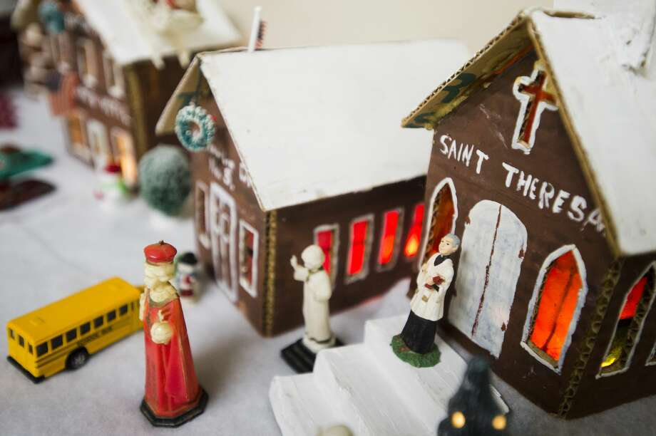 The Saint Theresa church is part of the Carbary family's cardboard recreation of the village of Kawkawlin and features a faux-stained glass window. (Katy Kildee/kkildee@mdn.net) Photo: (Katy Kildee/kkildee@mdn.net)