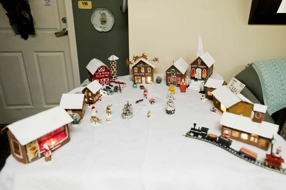 The Carbary family's cardboard recreation of the village of Kawkawlin features several handmade buildings and figurines. (Katy Kildee/kkildee@mdn.net) Photo: (Katy Kildee/kkildee@mdn.net)