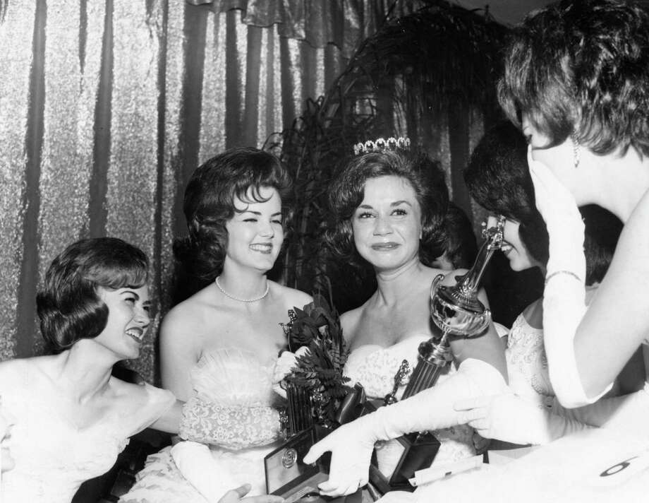 From the June 23, 1963, Houston Post: Miss Sandra Aycock (Dossett), center, her arms laden with trophies, smiled through her tears when she won the title, Miss Houston of 1963, in the Sheraton-Lincoln Hotel. Other finalists congratulate her. From the left: Linda Jericho, Diane Balloun, Miss Aycock, Joan Neel (partly hidden), and Pat Moran. Sandra, 18, a green-eyed brunette, will represent Houston in the Miss Texas Pageant in Fort Worth July 30-Aug 5. She is a graduate of San Jacinto High School. Runners-up in the contest were Jannis Stallworth and Charlotte Ford. Photo: Jim Morgan, Handout
