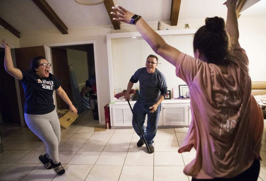 Rebecca Rodriguez, 16, Juan Rodriguez and Karen Rodriguez, 19, play games at their home in Houston. Photo: Marie D. De Jesus/Houston Chronicle