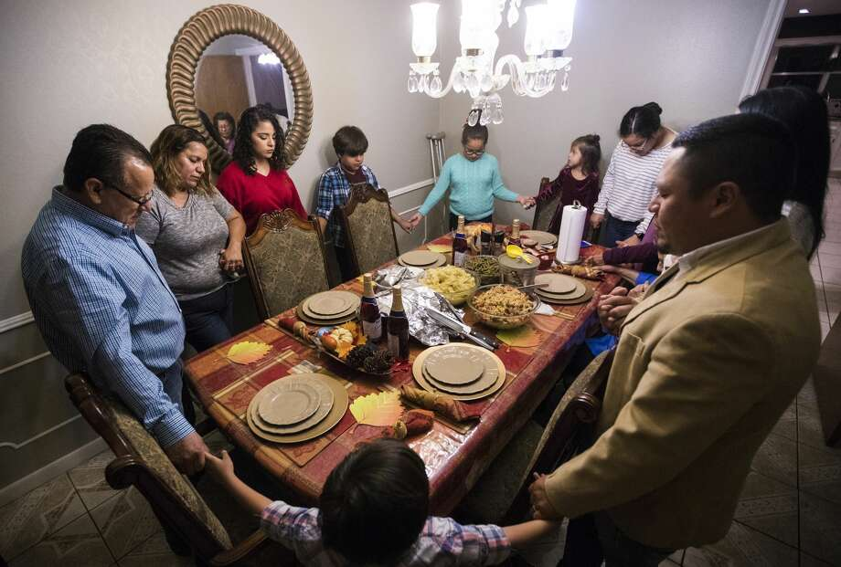 In the middle of their uncertainties and fights against deportation, The Rodriguezes find time to say a prayer with their extended family on Thanksgiving Day during a dinner at their home in Houston. Photo: Marie D. De Jesus/Houston Chronicle