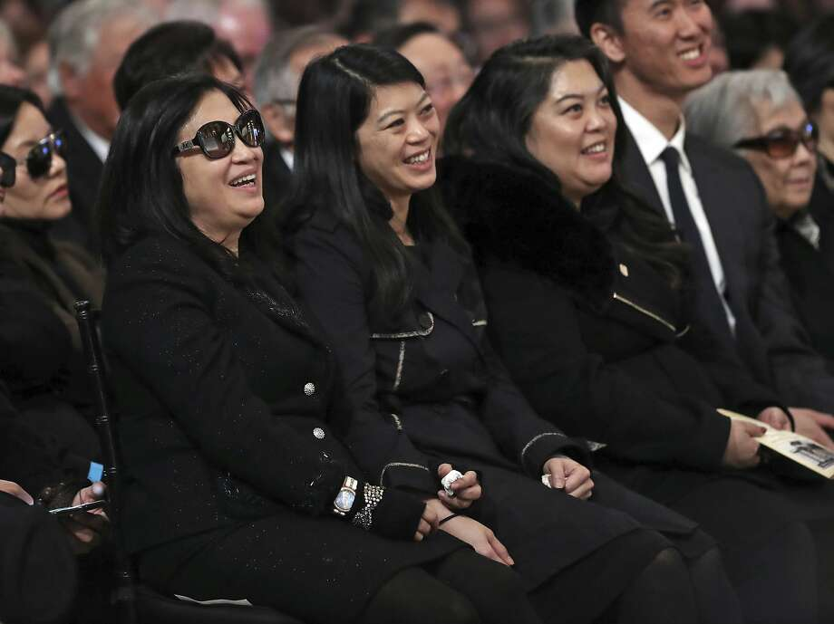 Mayor Ed Lee's wife, Anita Lee, and daughters, Brianna, middle, and Tania, laugh as former San Francisco Mayor Willie Brown reminisces about Lee during a City Hall service Sunday celebrating the late mayor's life. Photo: Scott Strazzante, Associated Press