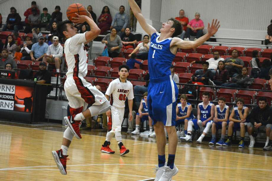 Plainview Christian Academy's Todd Earhart, right, blocks a shot by a Lockney player during a game earlier this week. Earhart scored 31 points Tuesday in PCA's 78-75 loss to Lorenzo. Photo: Skip Leon/Plainview Herald