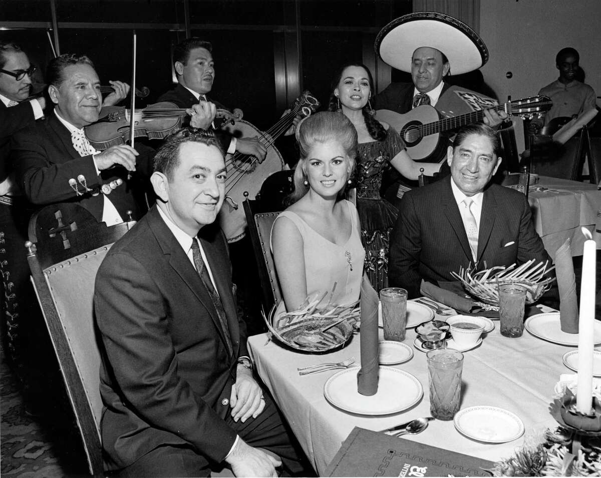 February 1968: El Chico International Manager Augie Cuellar, left, Miss Houston Bonnie Robinson and El Chico President Mack Cuellar snapped during El Chico's Fiesta Days celebration.