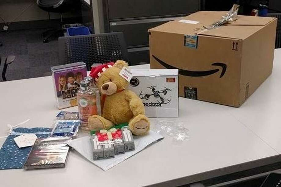 A stuffed toy bear in a Santa hat was among the goods stolen from porches in Hayward and recovered Wednesday by police, who arrested two men suspected of swiping a package that officers equipped with a tracking device. Photo: Hayward Police Department / /