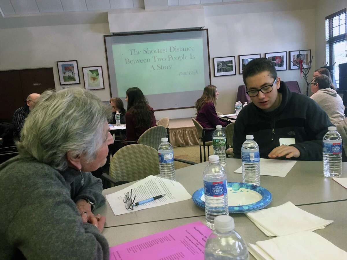 Staples High School students and seniors from the Westport Center for Senior Activities take part in a writers workshop on Sunday.