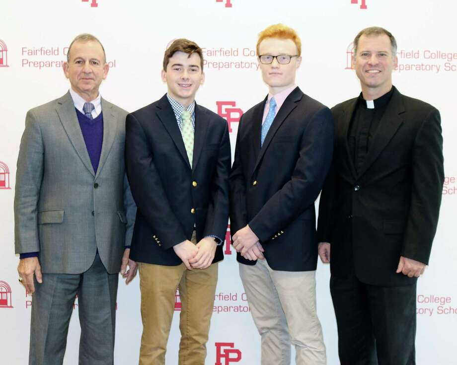 """Two Fairfield Prep seniors have been named commended scholars in the National Merit Scholarship Program. From left: Principal Robert Perrotta, Alexander McMullen, John """"Jack"""" Llewellyn and President Rev. Thomas Simisky. Photo: Contributed / Contributed Photo / Fairfield Citizen"""