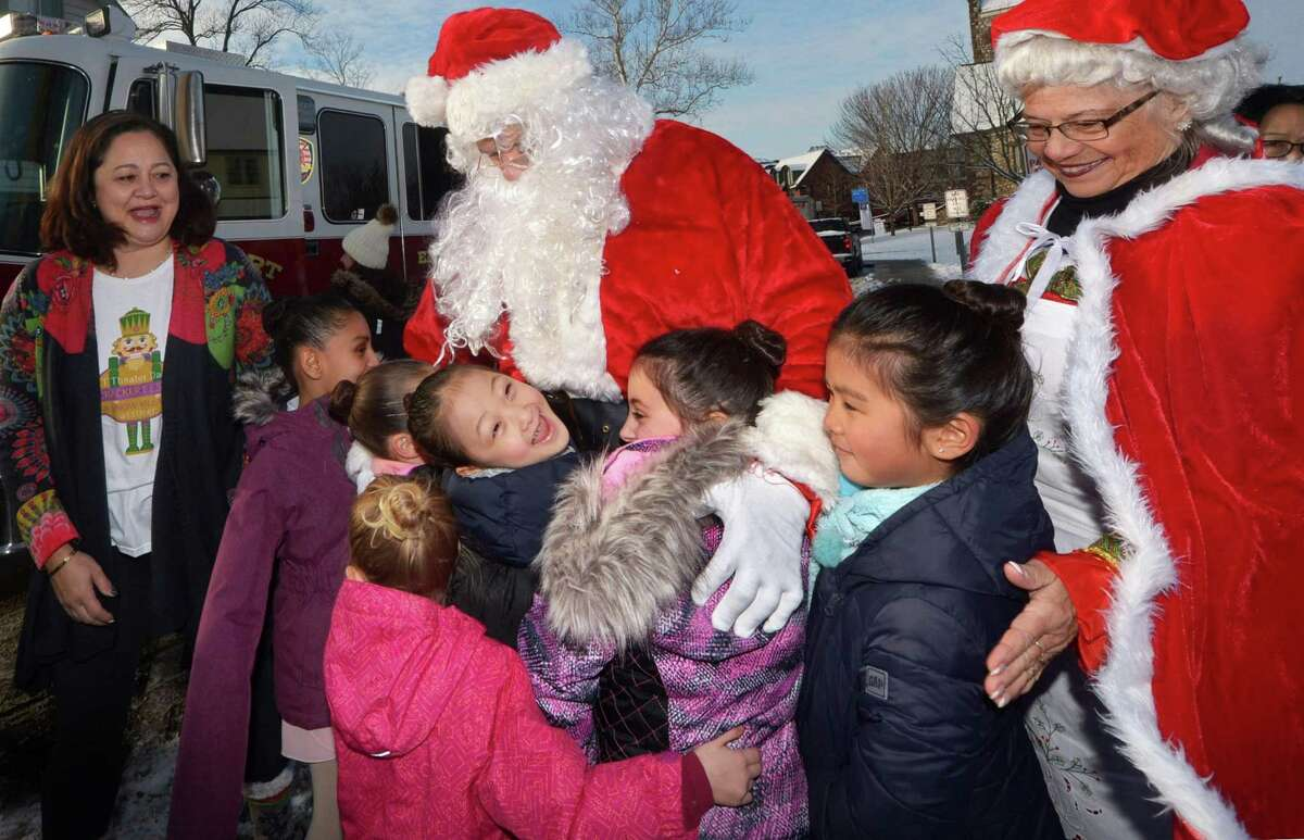 Santa Claus, portrayed by Tim Nevitt, and Mrs. Claus, portrayed by Darlene LeFavour, are greeted by Abigail Guo, 6, center, her fellow Connecticut Theater Dancers and Michelle Sperry, left, after arriving by fire truck during the two-day Nutcracker Festival Dec. 16 at Christ and Holy Trinity Church in downtown Westport.