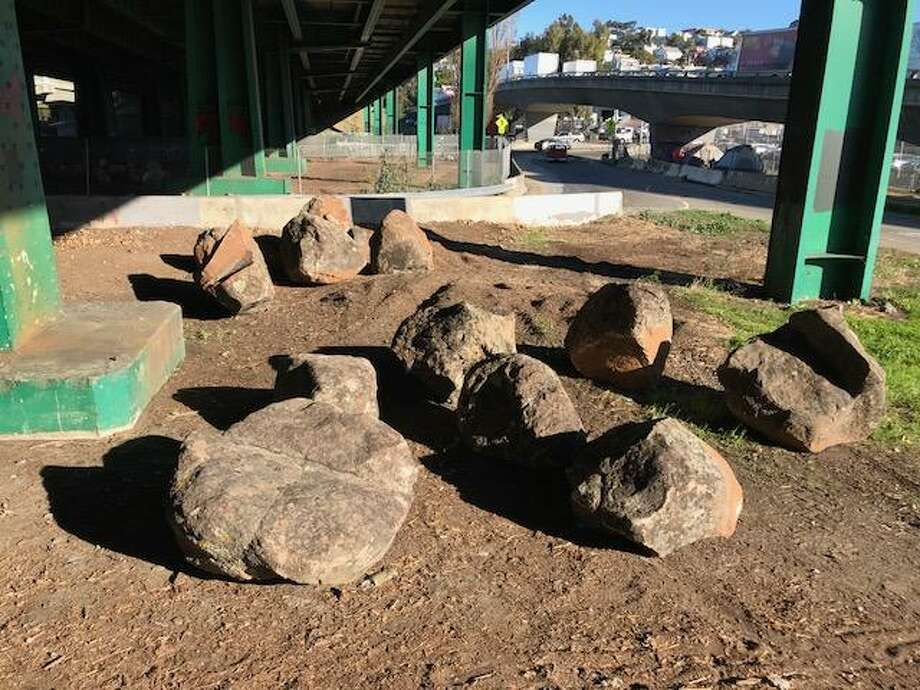 Boulders meant to discourage homeless tent camps were placed under Highway 101 near Cesar Chavez Street in San Francisco in December. Photo: Kevin Fagan / The Chronicle / /