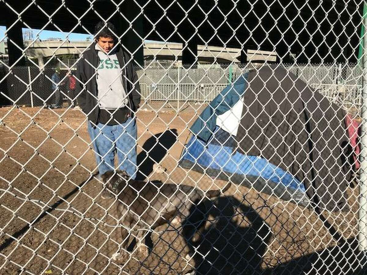 James Ayres set up his tent at the Hairball homeless camp in December after city workers installed boulders nearby to discourage camping.