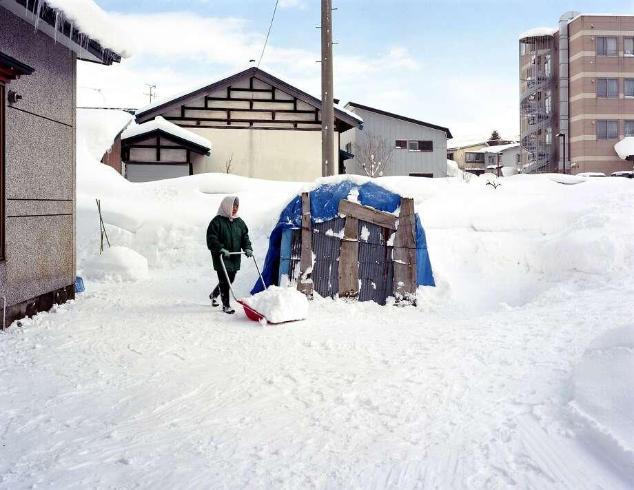 """Hiroyo Kaneko's image, """"Snow Shoveling,"""" was taken after a tsunami in Japan. Photo: Hiroyo Kaneko, Courtesy Jenkins Johnson GAllery"""