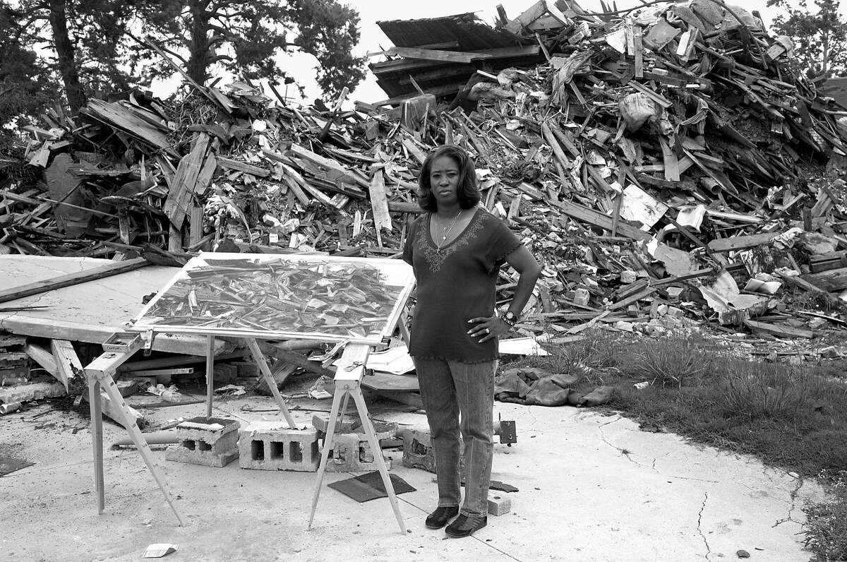 By the remains of the house built by her father, Lower Ninth Ward, 2006 archival pigment print35 x 44 inches
