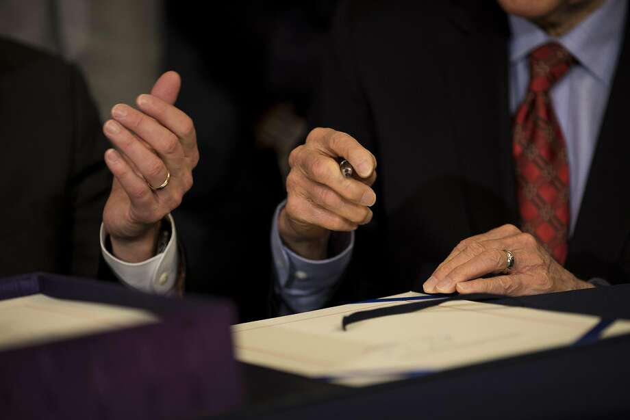Speaker of the House Paul Ryan, R-Wis., and Sen. Orrin Hatch, R-Utah, prepare to sign the Tax Cuts and Jobs Act during an enrollment ceremony at the U.S. Capitol in Washington, D.C., on Thursday, Dec. 21, 2017. Republicans want to channel momentum from the GOP's victory on taxes into a push to overhaul the nation's welfare programs, though some of President Donald Trump's advisers prefer a less controversial infrastructure plan at the top of his agenda. Photo: Aaron P. Bernstein, Bloomberg
