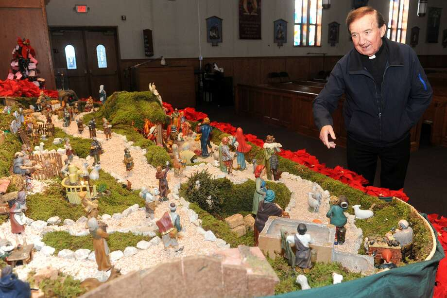 Monsignor Matthew Bernelli views the large nativity displays that he has constructed this year in the sanctuary of St. Andrew Church, in Bridgeport, Conn. Dec. 13, 2017. Bernelli, who is retired after many years at St. Mary's Church, also in Bridgeport, has continued his long tradition of building and displaying the nativity in the weeks leading up to Christmas. Photo: Ned Gerard / Hearst Connecticut Media / Connecticut Post