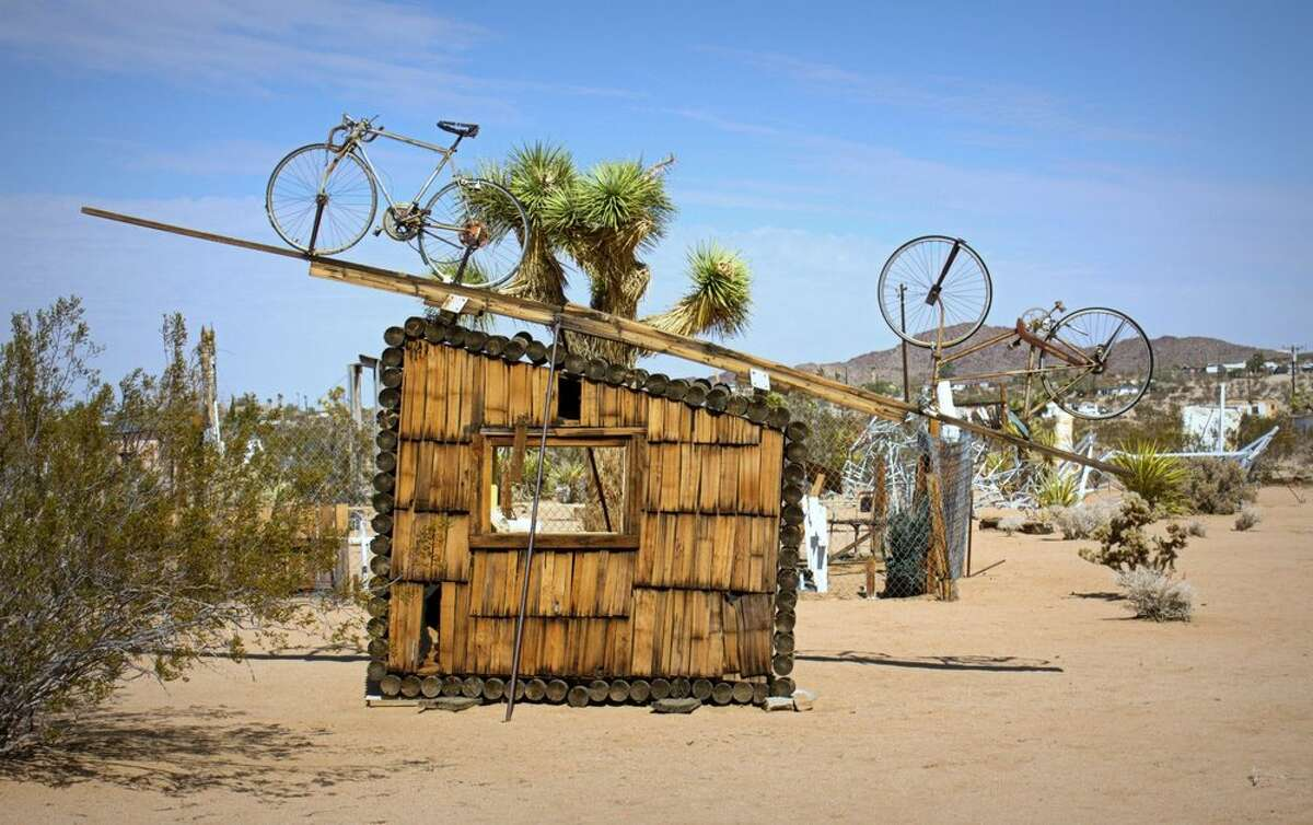 Artist Noah Purifoy lived and worked for most of his life in Los Angeles, where he pioneered assemblage sculptures, including a famous body of work created from the wreckage of the 1965 Watts Riots. Purifoy moved to the Mojave Desert in the 1980s, where he built hundreds of sculptures on 10 acres of land near the town of Joshua Tree. The art now comprises the Noah Purifoy Outdoor Art Museum and is free to visit.