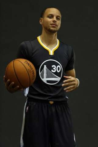 4e195b3d33b Golden State Warriors  Stephen Curry is photographed with the new alternate  uniform on media day