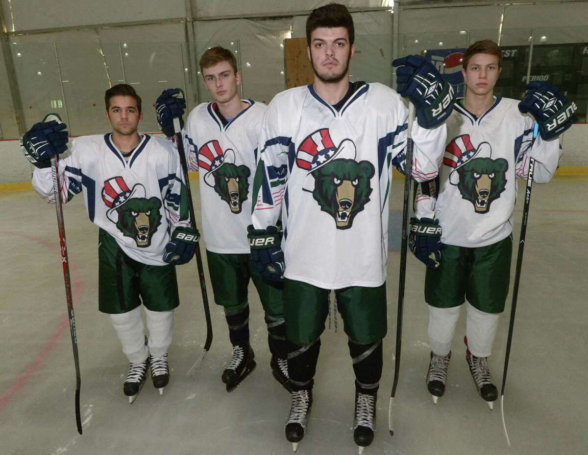 Norwalk-McMahon boys hockey captains, Dylan Persons, Remy Gibson, Kevin Remson and Brian Denke, show off their new jerseys Wednesday, December 13, 2017, featuring a new logo made specifically for the co-op hockey program which combines the two high school logos while the captains attend pratice at The Rink at Veterans Park in Norwalk, Conn.