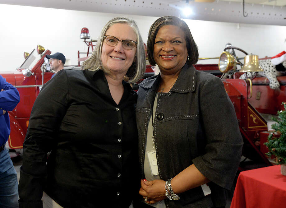 Beaumont Fire Chief Anne Huff poses with Sherry Ulmer during her retirement party at the Fire Museum Thursday. Huff, the city's first female chief, served 31 years with the department. Photo taken Thursday, December 21, 2017 Kim Brent/The Enterprise Photo: Kim Brent / BEN