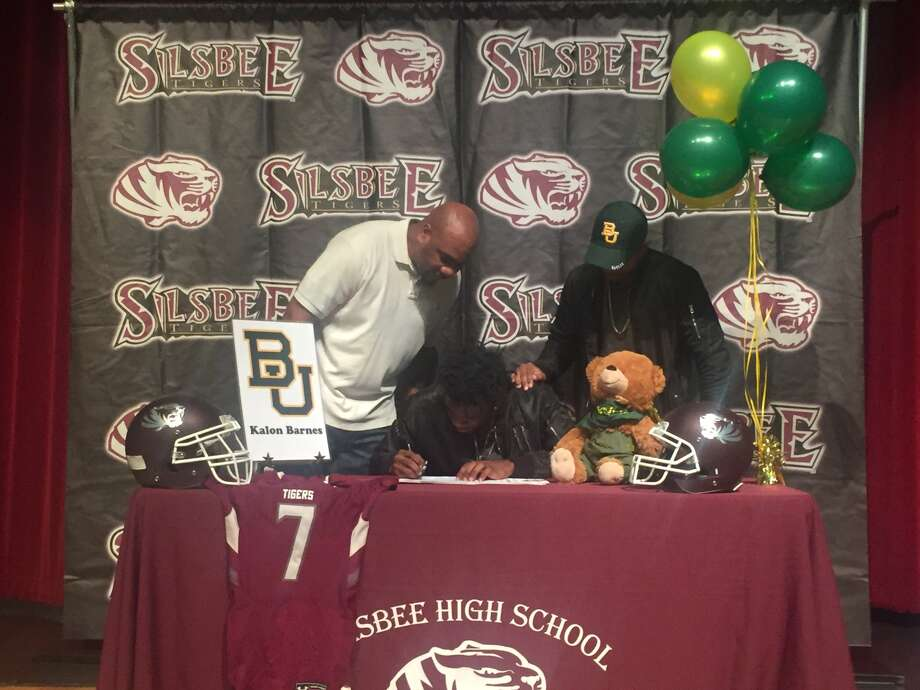 Silsbee receiver Kalon Barnes signs his National Letter of Intent on Dec. 21 at Silsbee High School. (Photo by Matt Faye.)