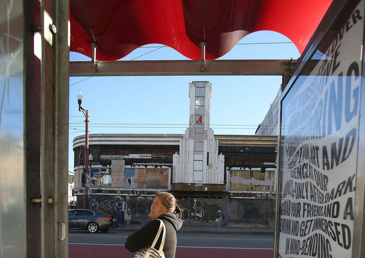 A local nonprofit has bought 2205 Mission St., seen through a bus stop, and will redevelop it with child care center, Mission Dance, and 40 units of family-sized affordable housing on Thursday, December 21, 2017, in San Francisco, Ca.