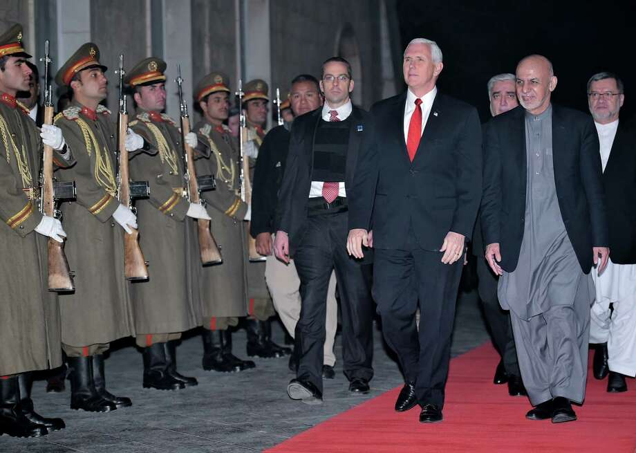 U.S. Vice President Mike Pence walks with Afghan President Ashraf Ghani upon arrival at the President Palace in Kabul, Afghanistan, on Thursday, Dec. 21, 2017. (Mandel Ngan/Pool via AP) Photo: Mandel Ngan, AP / Pool AFP