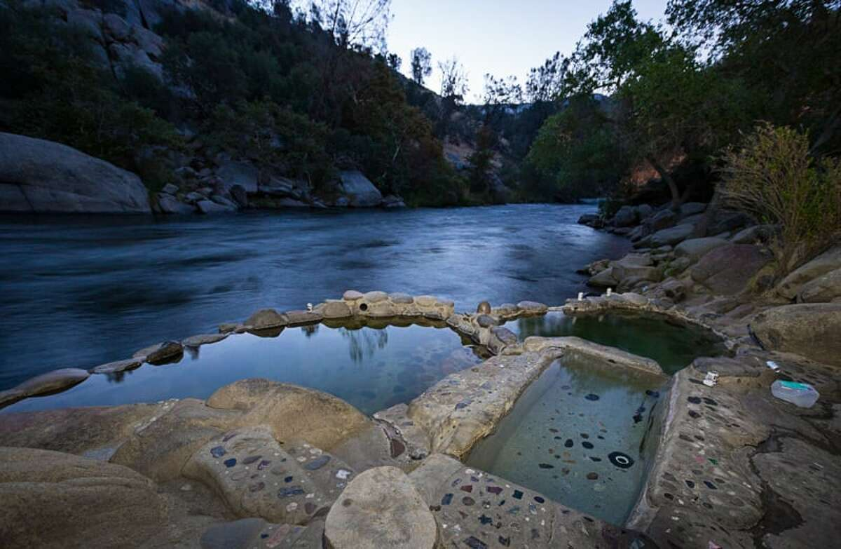A steep descent down a gravely path shoots out at the warm, smelly Remington Hot Springs near the Hobo Campground. Three smaller pools empty into a larger spring, which are kept clean and garbage-free by a team of volunteers.