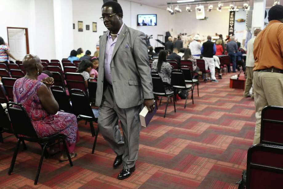 Bible in hand, Jarvis Moore leaves the Victory Gospel Chapel on the East Side following a recent Sunday service. Moore, a convicted murderer, has since dedicated his life preaching to and hiring ex-convicts. A reader says his story reflects the power of redemption. Photo: JERRY LARA /San Antonio Express-News / © 2017 San Antonio Express-News