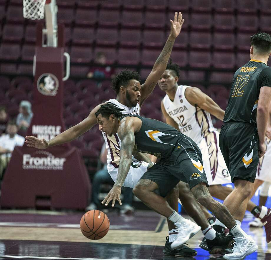 Florida State guard PJ Savoy draws a charge agianst Southern Mississippi guard Dominic Magee in Tallahassee, Fla. Photo: Mark Wallheiser, Associated Press