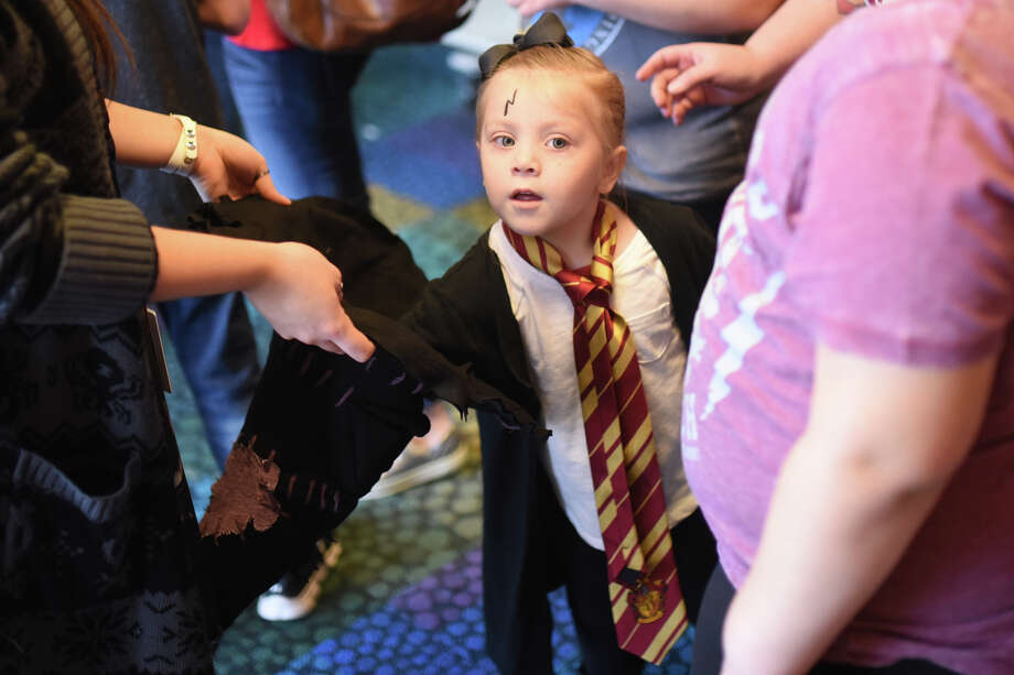 Gabby Rodriguez, age 4, reaches into the sorting hat during a Harry Potter-themed Hogwarts Holiday event Dec. 21, 2017, at the Midland County Public Library Centennial Branch. James Durbin/Reporter-Telegram Photo: James Durbin