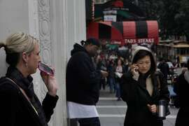 Powell Street pedestrians on their cell phones. A new study from Kaiser showed that radiation from cell phones and wi-fi networks greatly increases the risk of miscarriage, joining a body of research linking this radiation to damage in humans.