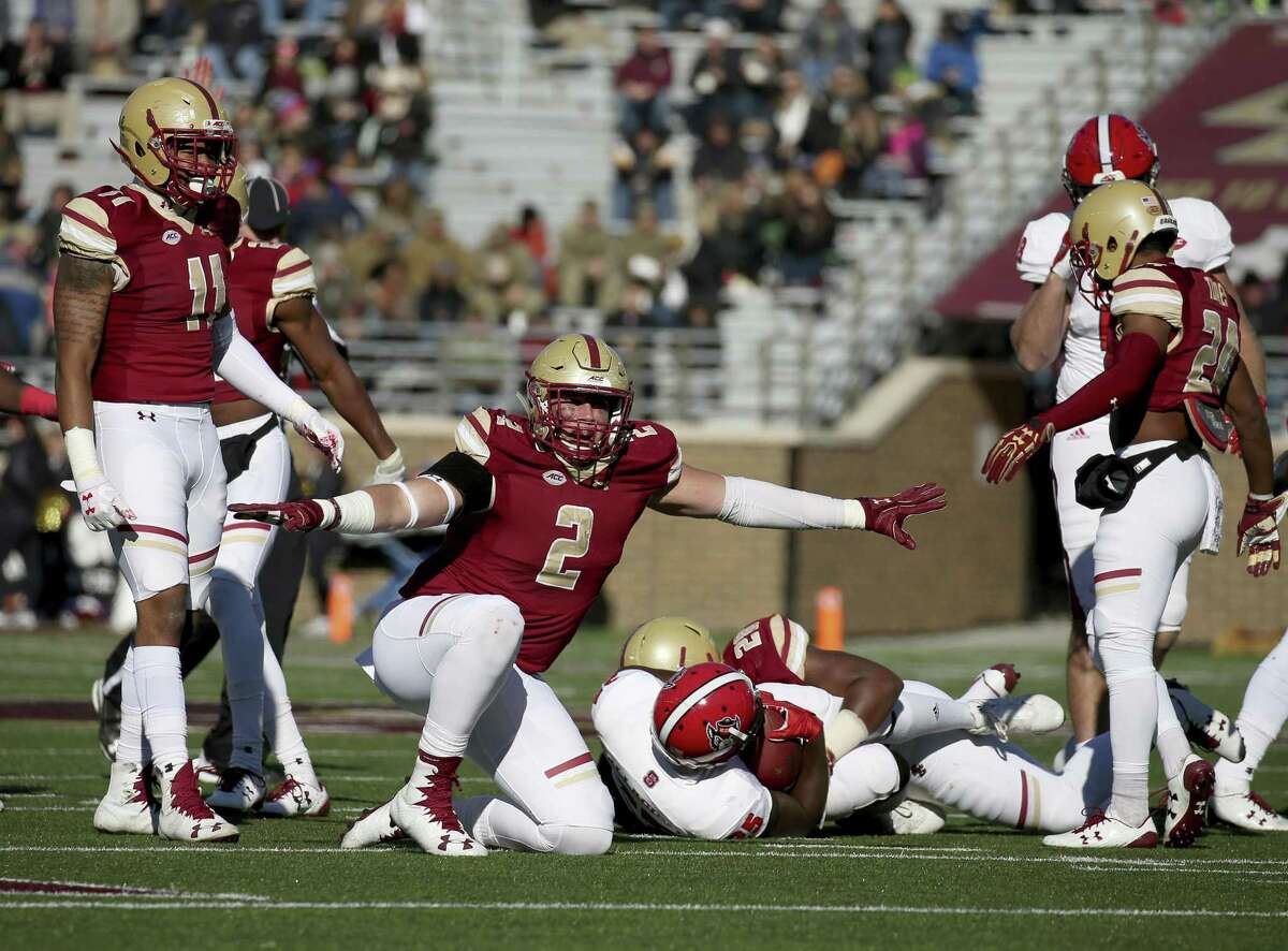Boston College defensive end Zach Allen (2) celebrates a defensive stop against North Carolina State during the first half of an NCAA college football game Saturday, Nov. 11, 2017, in Boston. (AP Photo/Mary Schwalm)