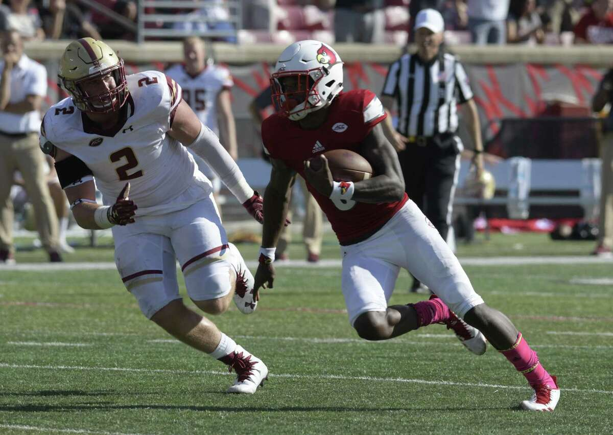 Louisville quarterback Lamar Jackson (8), right, attempts to outrun the pursuit of Boston College defensive end Zach Allen (2) during the second half of an NCAA college football game, Saturday, Oct. 14, 2017, in Louisville, Ky. Boston College won 45-42. (AP Photo/Timothy D. Easley)