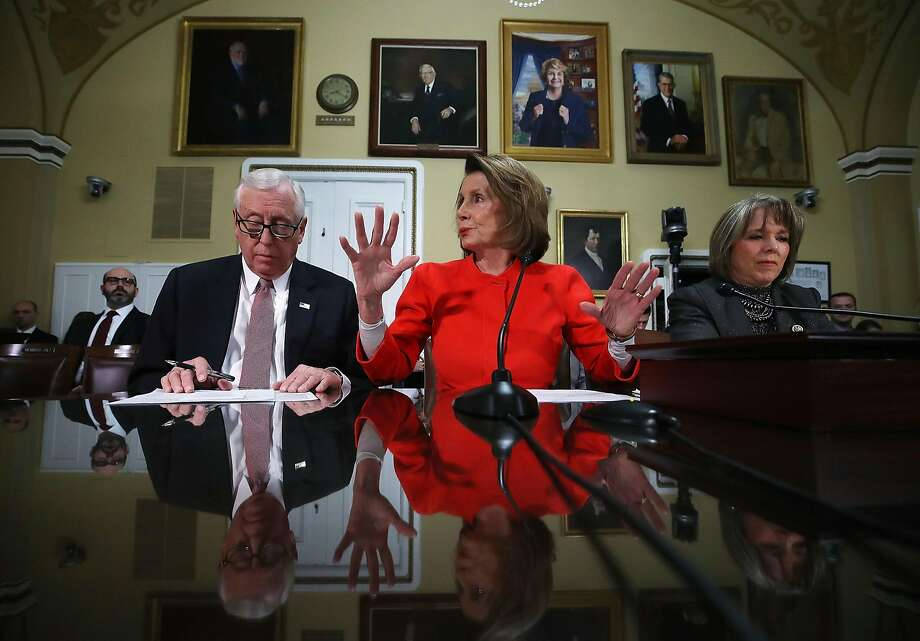 House Minority Leader Nancy Pelosi (center), flanked by fellow Democratic Reps. Steny Hoyer and Michelle Lynn Lujan Grisham, discusses legislation to avert a government shutdown. Photo: Mark Wilson, Getty Images