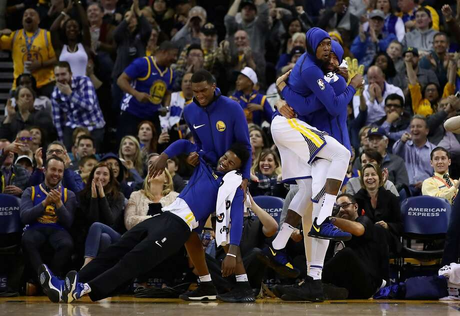 OAKLAND, CA - DECEMBER 20:  Jordan Bell #2, Kevon Looney #5, Kevin Durant #35 and JaVale McGee #1 of the Golden State Warriors celebrate after the Warriors made a basket against the Memphis Grizzlies at ORACLE Arena on December 20, 2017 in Oakland, California. NOTE TO USER: User expressly acknowledges and agrees that, by downloading and or using this photograph, User is consenting to the terms and conditions of the Getty Images License Agreement.  (Photo by Ezra Shaw/Getty Images) Photo: Ezra Shaw, Getty Images