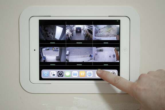 A wall-mounted ipad is part of the home security system installed by Alice Petty and Jason Hogg in their home in San Francisco, Calif., on Tuesday, December 19, 2017. The couple installed the system in their Glen Park home, and recently capturing video of a porch pirate opening a package and stealing a keyboard they ordered online. The couple installed a Ring video doorbell, two other cameras, and a series of iPads inside so they can monitor the security video, which is stored on a local network storage drive.