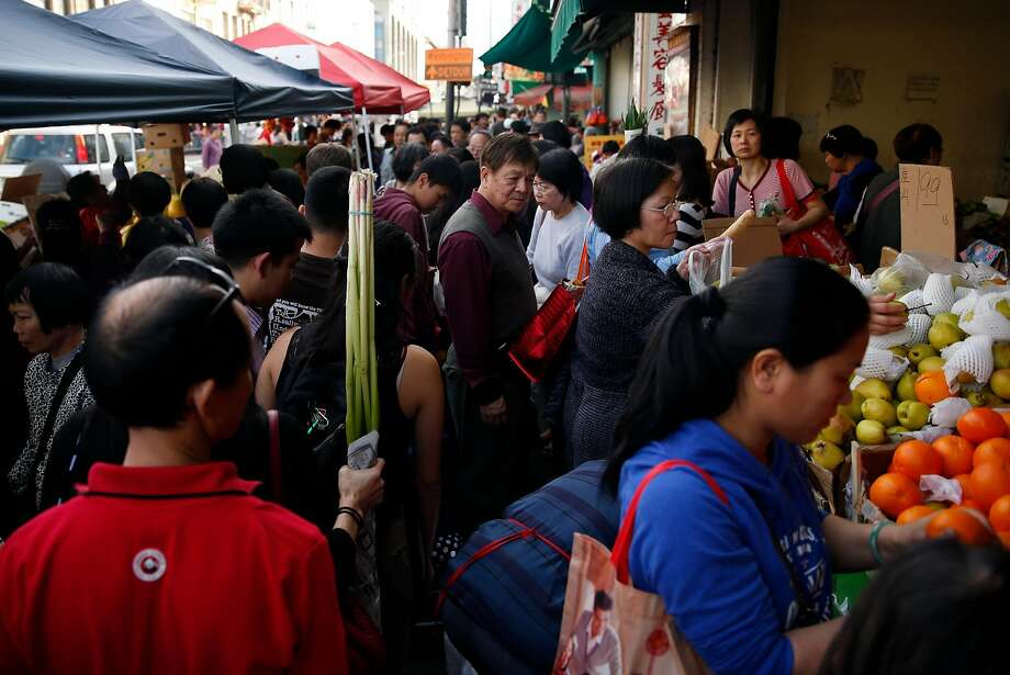 Crowded sidewalk on Stockton Street in Chinatown in San Francisco, Calif. on Saturday, February 15, 2015. Photo: Scott Strazzante, The Chronicle
