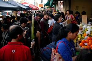 Crowded sidewalk on Stockton Street in Chinatown in San Francisco, Calif. on Saturday, February 15, 2015.