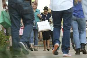 Shoppers make their way Thursday afternoon, Dec. 21, 2017 through the Shops at La Cantera on the last weekend before Christmas. About 6 percent of shoppers told the National Retail Federation they won't finish their holiday gift buying until Sunday.