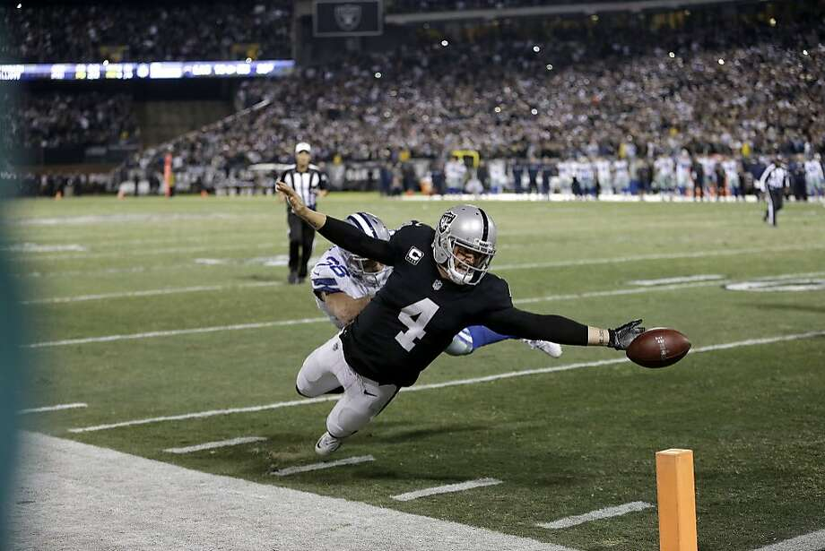 Oakland Raiders quarterback Derek Carr (4) fumbles the ball into the end zone in front of Dallas Cowboys strong safety Jeff Heath (38) during the second half of an NFL football game in Oakland, Calif., Sunday, Dec. 17, 2017. The play was ruled a touchback and the Cowboys got possession. The Cowboys won 20-17. (AP Photo/Ben Margot) Photo: Ben Margot, Associated Press