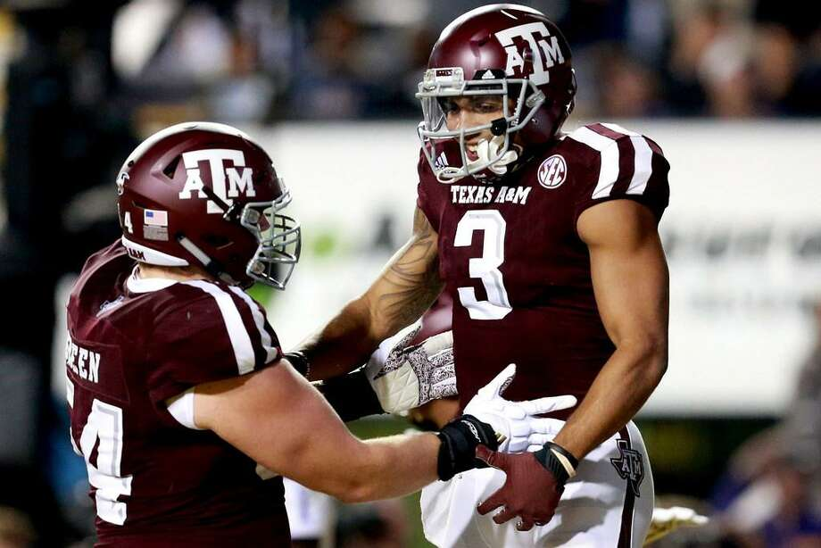 Christian Kirk, right, celebrates with Carson Green of the Texas A&M Aggies after scoring a touchdown during the second half of a game against LSU at Tiger Stadium on Nov. 25, 2017 in Baton Rouge, Louisiana. LSU won the game 45-21. Photo: Sean Gardner /Getty Images