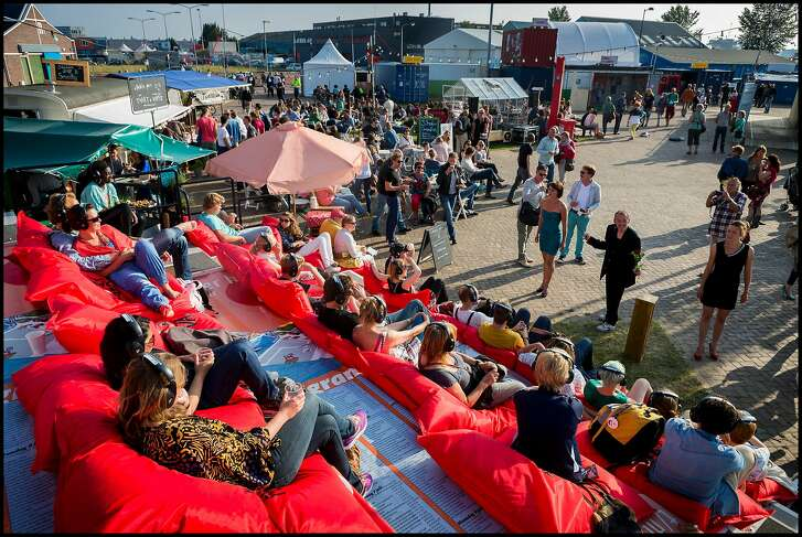 Crowds attend the Over het IJ Festival, an annual theatre festival that brings inspirational theatre and cuisine the Amsterdam Noord area every July.