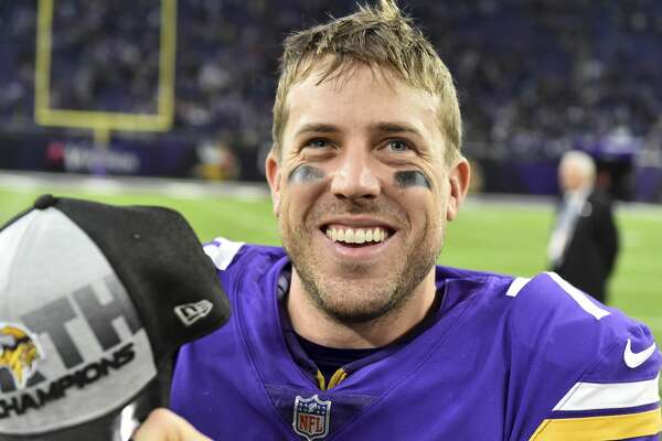 Minnesota Vikings quarterback Case Keenum celebrates on the field after an NFL football game against the Cincinnati Bengals, Sunday, Dec. 17, 2017, in Minneapolis. The Vikings won 34-7. (AP Photo/John Autey)