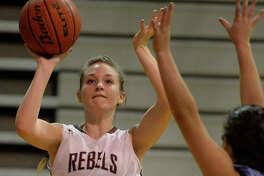 Lee's Mackenzie Ross (23) shoots against Greenwood's Ariana Leyva (23) on Dec. 21, 2017 at Lee High School. James Durbin/Reporter-Telegram