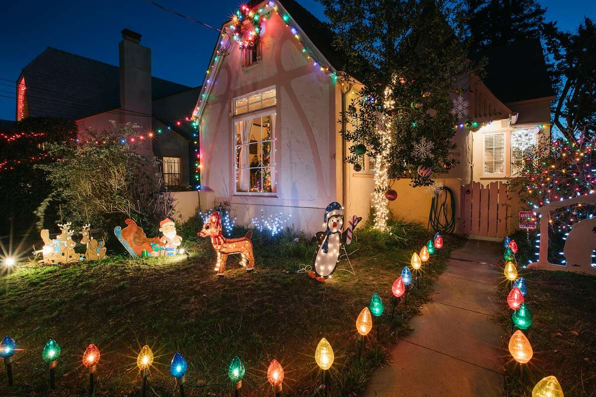 Holiday decorations in the front yard of one of the many homes decorated by homeowners in a community that lives along Picardy Ave, in Oakland, California, on December 9th, 2017. This particular block has a tradition of decorating and gathering for a tree lighting in the center island of the street that dates back to the mid-20th century.
