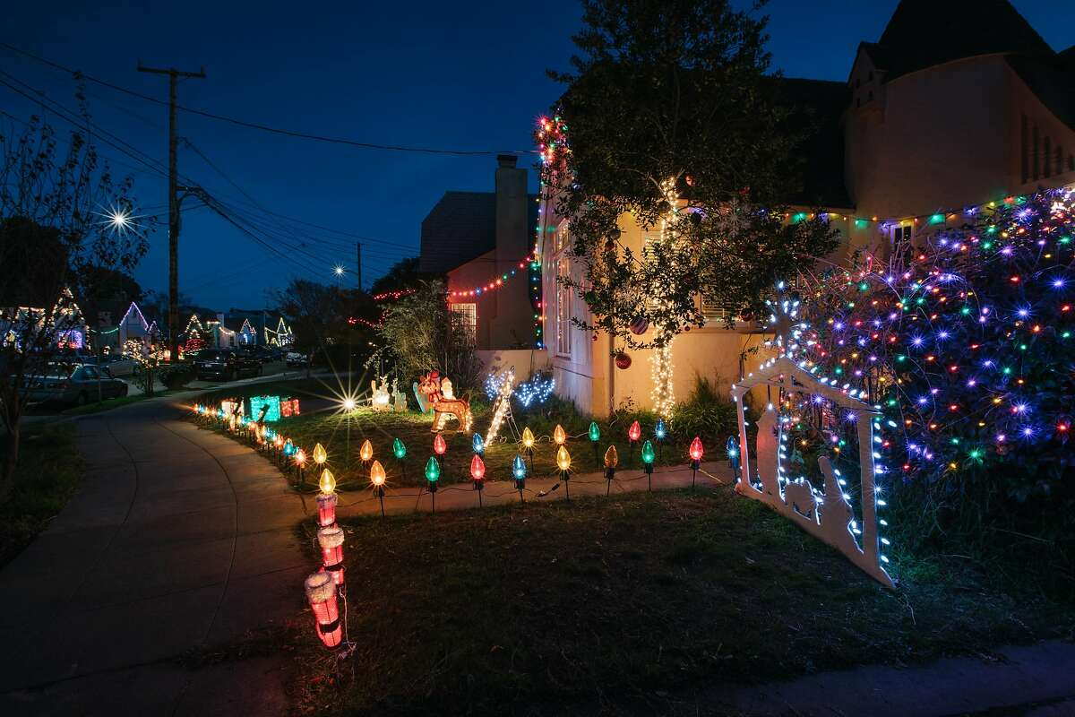 Homes decorated for the holiday in a community that lives along Picardy Ave, in Oakland, California, on December 9th, 2017. This particular block has a tradition of decorating and gathering for a tree lighting in the center island of the street that dates back to the mid-20th century.