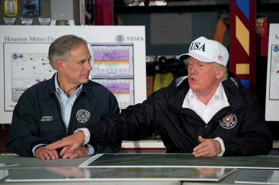 President Donald Trump sits with Texas Gov. Greg Abbott during a briefing on Hurricane Harvey in Corpus Christi on Aug. 29, 2017. (AFP/Getty Images) Photo: JIM WATSON, Contributor / AFP or licensors