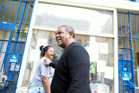 Director Joe Wilson gives an employee a cheerful greeting outside the Hospitality House, where he once found shelter himself. Photo: Michael Short, Special To The Chronicle