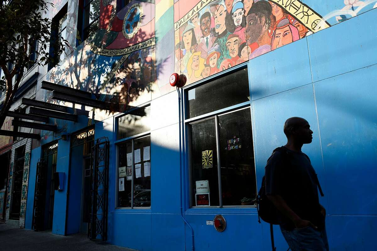 A person walks past the Hospitality House, a homeless outreach non-profit that recently celebrated it's 50th year of operation, in San Francisco, Calif., on Wednesday December 13, 2017.