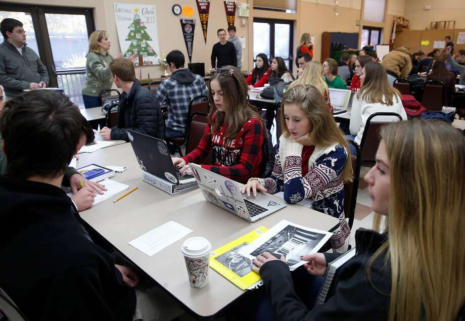 Cardinal Newman High School seniors in Bernadette Calhoun�s math class study at St. Joseph's Catholic Church in Cotati, Calif. on Thursday, Dec. 14, 2017. Cardinal Newman students and faculty are spread across four separate locations after the Tubbs Fire destroyed half of the campus. Photo: Paul Chinn, The Chronicle